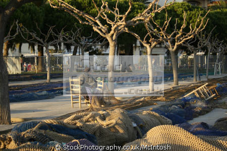fishing nets drying evening sun trees. cambril spain marine texturenets costa brava catalonia spanien españa espagne la spagna spanish