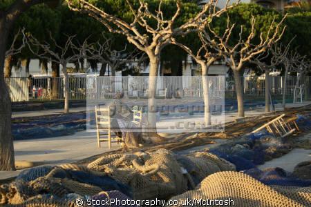 fishing nets drying evening sun trees. cambril spain marine texturenets costa brava catalonia spanien españa espagne la spagna spanish