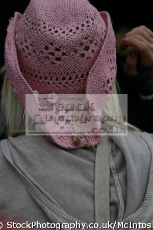 female wearing pink crochet hat grey hoody view rear young women woman females feminine womanlike womanly womanish effeminate ladylike stetson perth kinross perthshire scotland scottish scotch scots escocia schottland united kingdom british