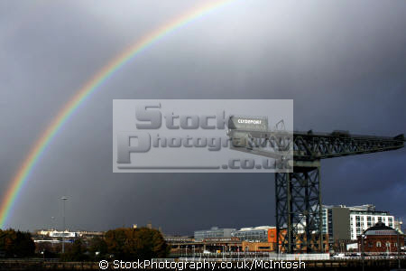 clydeport crane dark blue sky rainbow arching over. clydeside nationalities nations rain thunder walkway glasgow central scotland scottish scotch scots escocia schottland united kingdom british