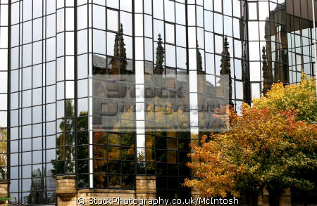 autumn leaves trees st andrews cathedral reflected mirrored glass fronted building uk cathedrals worship religion christian british architecture architectural buildings reflections glasgow central scotland scottish scotch scots escocia schottland united kingdom