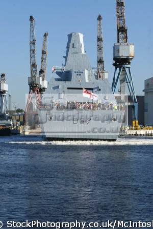 d37 hms duncan enters river clyde following successful launch. cranes background chain dust visible. 11 october 2010 warships royal navy naval navies uk military militaries frigate glasgow central scotland scottish scotch scots escocia schottland united kingdom british