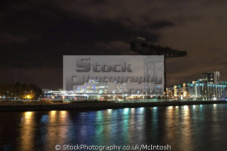 river clyde crane silhouetted city lights background clydeside nationalities nations glasgow central scotland scottish scotch scots escocia schottland united kingdom british