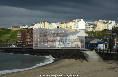 peel seafront dark rainclouds uk terraced houses british housing homes dwellings abode architecture architectural buildings manx storm clouds seaside resort isle man england english angleterre inghilterra inglaterra united kingdom