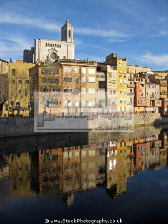 girona spain apartments businesses lining river onyar. distance cathedral french buildings european catedral catalonia esgl sia church espagne espa reflections sunset twilight religious catholic spanien la spagna