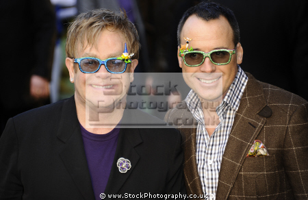elton john cbe english singer-songwriter singer songwriter singersongwriter composer pianist civil partner david furnish film director producer famous british celebrity couples spouses people fame celebrities star candle wind gay males white caucasian portraits