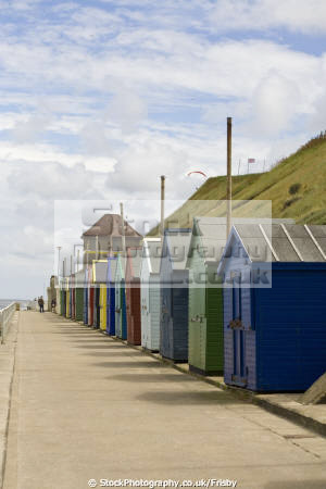 row brightly coloured beach huts promenade cromer norfolk england bright blus summer sky british seaside coastal resorts leisure hut coast holiday uk english angleterre inghilterra inglaterra united kingdom