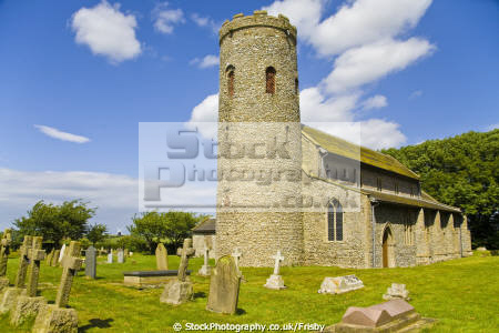 historic saxon round tower church burnham norton norfolk england churchurchyard windmill distance uk churches worship religion christian british architecture architectural buildings churchyard grave graveyard religious building english angleterre inghilterra inglaterra united kingdom