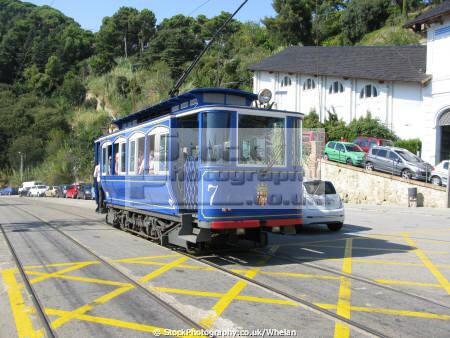 vinatage blue tram goes tibidado hill overlooking barcelona catalunya catalonia spanish espana european vintage spain spanien espa espagne la spagna