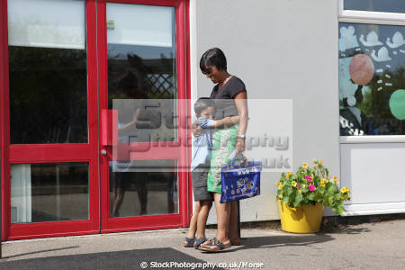 asian boy hugging mother greeting collects primary school multicultural ethnic minority son affection love summer family child children education learning junior asians