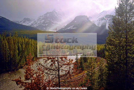 morant curve near lake louise alberta wilderness natural history nature meteorology crepuscular rays deadman rail track river bow valley banff sunset rockies alpine mountains cpr canada canadian