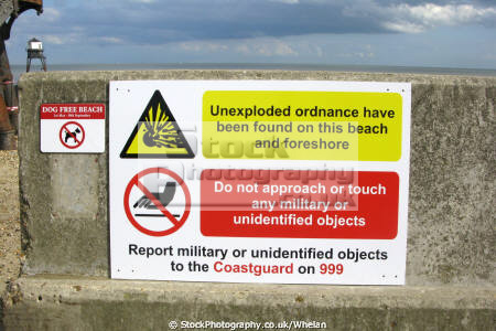 woman picked stone dovercourt beach throw dog boyfriend pointed looked bit like world war grenade uk coastline coastal environmental unexploded bomb sign harwich essex england english angleterre inghilterra inglaterra united kingdom british