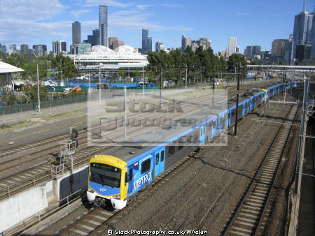 electric multiple unit melbourne city centre skyline background trains railways rail railroads transport transportation victoria australia australian