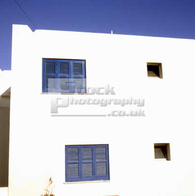greek house tradtional blue shuttered windows european travel mykonos island dodcanese islands greece europe
