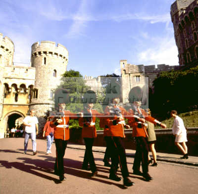 guardsmen marching like toy soldiers windsor castle british castles architecture architectural buildings uk sentry sentinel defend royal queen residence berkshire england english angleterre inghilterra inglaterra united kingdom