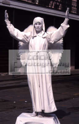angel religion worship faith religious belief working people persons pray fake statue street performer performance art new orleans big easy louisiana southern state usa united states america american