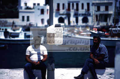 greek men harbour wall european travel mykonos greece loafing chat laze island dodcanese islands europe