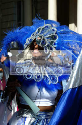 smiling black lady blue costume notting hill carnival london events capital england english uk culture street colour color parade celebrate afro carribean party kensington chelsea cockney angleterre inghilterra inglaterra united kingdom british