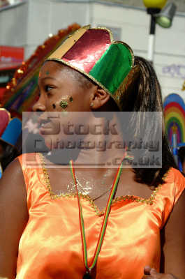 carnival girl looks shoulder notting hill london events capital england english uk black culture street colour color parade celebrate afro carribean party kensington chelsea cockney angleterre inghilterra inglaterra united kingdom british