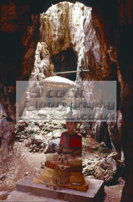 buddha statue cave petchburi thailand asian travel religious religion pray holy god asia thai