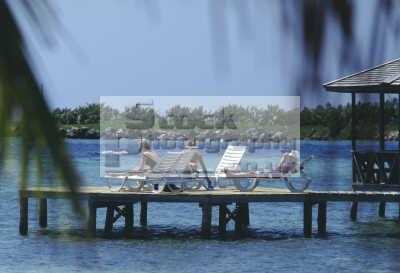 sunbather jetty central america american travel beach sun sand suntan laze lounge vacation caribbean oceans mexico mexican