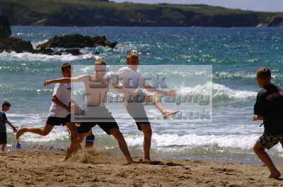 young men playing beach football adult males masculine manlike manly manful virile mannish people persons energetic vibrant newquay cornish cornwall england english angleterre inghilterra inglaterra united kingdom british