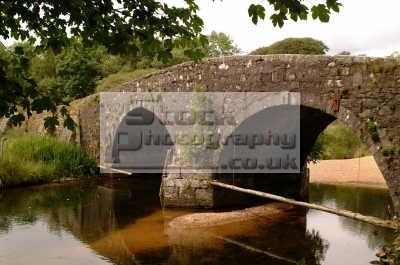 bridge troubled waters dartmoor uk bridges rivers waterways countryside rural environmental arches devon devonian england english angleterre inghilterra inglaterra united kingdom british