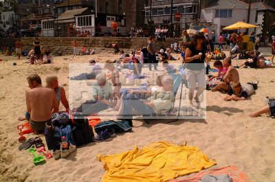st ives beach holidaymakers british beaches coastal coastline shoreline uk environmental sea seashore waterfront bathing sands strand cornish cornwall england english angleterre inghilterra inglaterra united kingdom